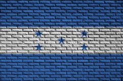 Honduras flag is painted onto an old brick wall stock image