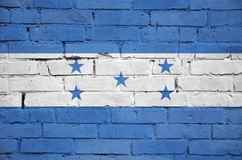 Honduras flag is painted onto an old brick wall royalty free stock photos