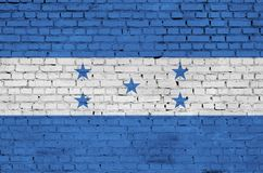 Honduras flag is painted onto an old brick wall royalty free stock images