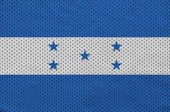 Honduras flag printed on a polyester nylon sportswear mesh fabri. C with some folds royalty free stock photos