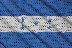Honduras flag printed on a polyester nylon sportswear mesh fabri. C with some folds royalty free stock photo