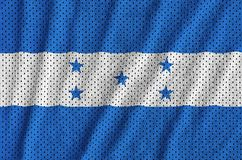 Honduras flag printed on a polyester nylon sportswear mesh fabri. C with some folds royalty free stock photography