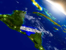 Honduras with flag in rising sun Stock Photography