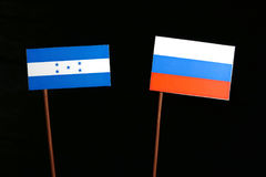 Honduras flag with Russian flag on black. Background royalty free stock photos