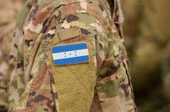 Honduras flag on soldiers arm. Honduras troops collage.  royalty free stock photos