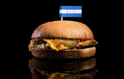 Honduras flag on top of hamburger on black. Background stock photos