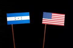 Honduras flag with USA flag on black. Background royalty free stock photography