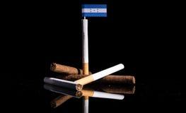 Honduras flagga med cigaretter och cigarrer Royaltyfri Bild