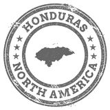 Honduras grunge rubber stamp map and text. Round textured country stamp with map outline. Vector illustration Stock Photos