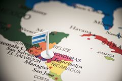 Honduras marked with a flag on the map.  stock images