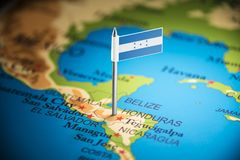 Honduras marked with a flag on the map.  royalty free stock image