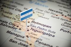 Honduras marked with a flag on the map.  royalty free stock photo