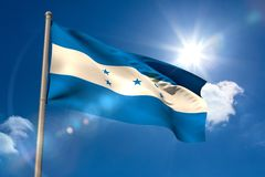 Honduras national flag on flagpole Stock Photos