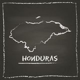 Honduras outline vector map hand drawn with chalk. Honduras outline vector map hand drawn with chalk on a blackboard. Chalkboard scribble in childish style Stock Photos
