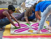Honduras Semana Santa, the Alfombra Stencils. Filling in the stencils with different colored sawdust. All hand assembled by volunteers royalty free stock photos
