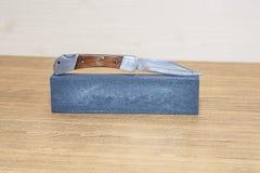 Hone and pocket knife Stock Photo