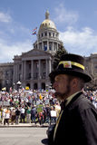'Honest Abe' at Tea Party Rally, Denver. DENVER, COLORADO – APRIL 15: A man dressed as Abraham Lincoln stands in front of the state capital at the Tea Party Royalty Free Stock Photo
