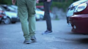 Honest man returning lost wallet to owner on street, human support and help. Stock footage stock footage