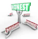 Honest Person Wins Vs Dishonest Competitors Strong Reputation Si. Honest 3d word lifted by person with strong reputation as competitors are crushed by their Royalty Free Stock Images