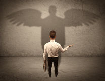 Honest salesman with angel shadow concept Royalty Free Stock Image