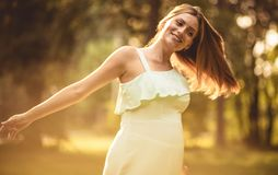 Honest smile and indescribable happiness. Happy pregnant woman spending time in nature. Close up royalty free stock images