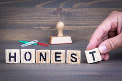 Honest from wooden letters on wooden background Stock Photography