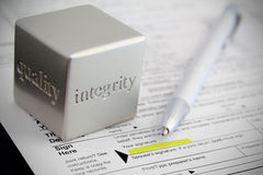 Honesty. Tax preparation honesty concept with vignette effect Royalty Free Stock Images