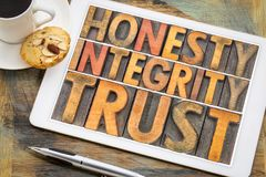 Honesty, integrity, trust word abstract in wood type stock photos