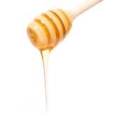 Honey. Stick with honey isolated on white Royalty Free Stock Photography