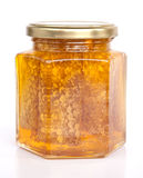 Honey. Open honey jar isolated on white Stock Images