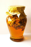 Honey. Gold honey with walnuts, isolated stock image