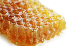 Honey. On white background (close-up, isolated Royalty Free Stock Photo