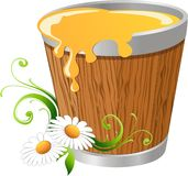 Honey. In a wooden bucket with daisy design Stock Images