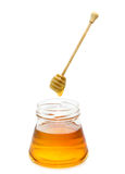 Honey. Fresh honey with stick isolated on white background stock photo