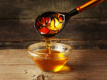 Honey. Wooden spoon, honey, glass bowl. Still life Stock Photo