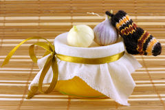 Honey.  garlic, warm socks on a beige background Royalty Free Stock Images