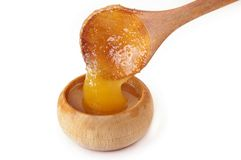 Honey. In wooden pot over white Royalty Free Stock Photos