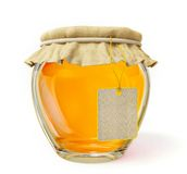 Honey. Bright honey in a glass jar isolated on white Stock Photos