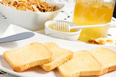 Honey. On the table with bisuits Stock Images