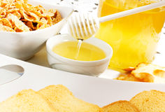 Honey. On the table with bisuits Royalty Free Stock Photography