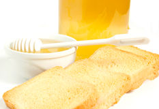 Honey. On a white background with bisuits Stock Image