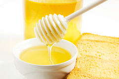 Honey. On a white background with bisuits Stock Images