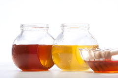 Honey. Over the white background Royalty Free Stock Photography