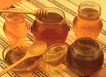 Honey. Jars with dipper and spoon Stock Image