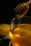 Honey. Drizzling. serving  of a pot Royalty Free Stock Images