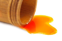 Honey. With wood cup isolated Royalty Free Stock Photos