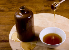 Honey. Wild honey falling into pot Stock Photo