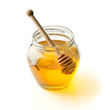 Honey. With wood stick isolated on white background Royalty Free Stock Images