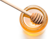 Honey. With wood stick isolated on white background Stock Image