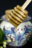 Honey. Acacia honey runny jar with ceramic Royalty Free Stock Photography